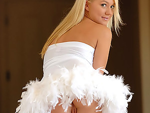 Alison Angel - This blonde busty is wearing a tiny white dress that somehow resembles the dress of a ballet dancer - but she looks more like a promiscuous stripper!