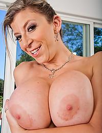 Shiny bikini on busty pornstar