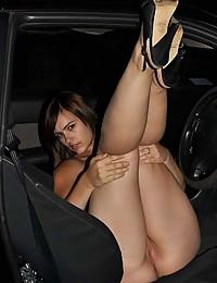 Photo collection of a wild babe masturbating in a car