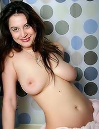 Abrianna - Busty gal posing in her pink bath robe
