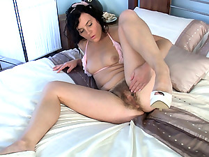 A huge hairy pussy like Sofia Matthews is just what you ordered. Let her show you how she handles her business. Stroking every inch of her pussy, this hairy chick knows how to finger herself right.