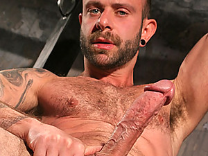 Bald beauty Johnny Gunn gives us a solo show in this video. He wears that chest rug so damn fine over his muscled pecs and that long cock is ripe for the work-out he gives it for the camera. This is one jerk-off session you'd kill to join in on.