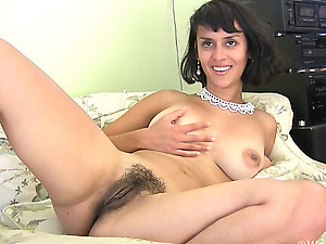 Laying comfortably on the couch in her leopard skirt and sweater top, Sonya N gets restless and takes off her clothes as she gets hot and horny! She is one hairy girl that likes to finger her pussy!