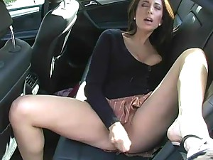 Big titted MILF babe masturbating in the car