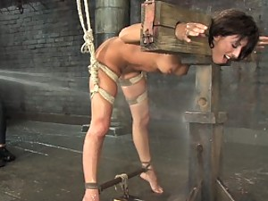 Fiery, sexy brunette gets bound and disciplined with water torture
