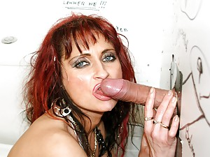 Skanky redhead slut enjoys a gloryhole cock