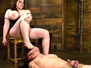 Slave boy licks her feet