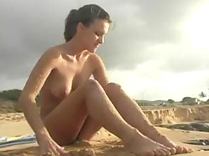 Sandy girl on a beach looks sexy