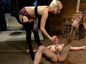 Hot blonde dominatrix tortures slave's cock with painful CBT clamps, stress position ass fucking, and using his cock for her own pussy's pleasure.