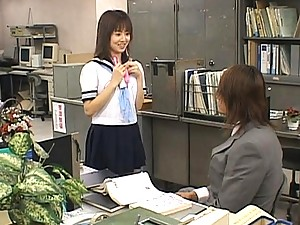 Akari Yaguchi teases her pussy on a table in an office room